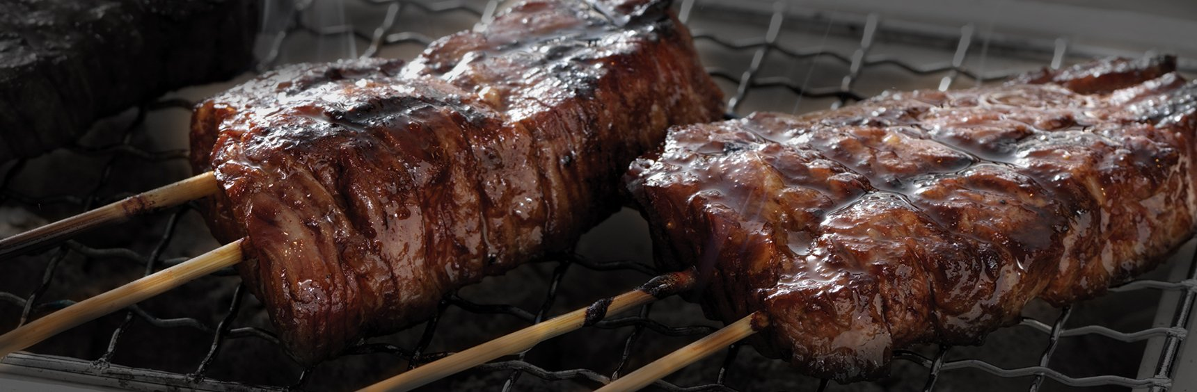 Japanese beef skewers on grill