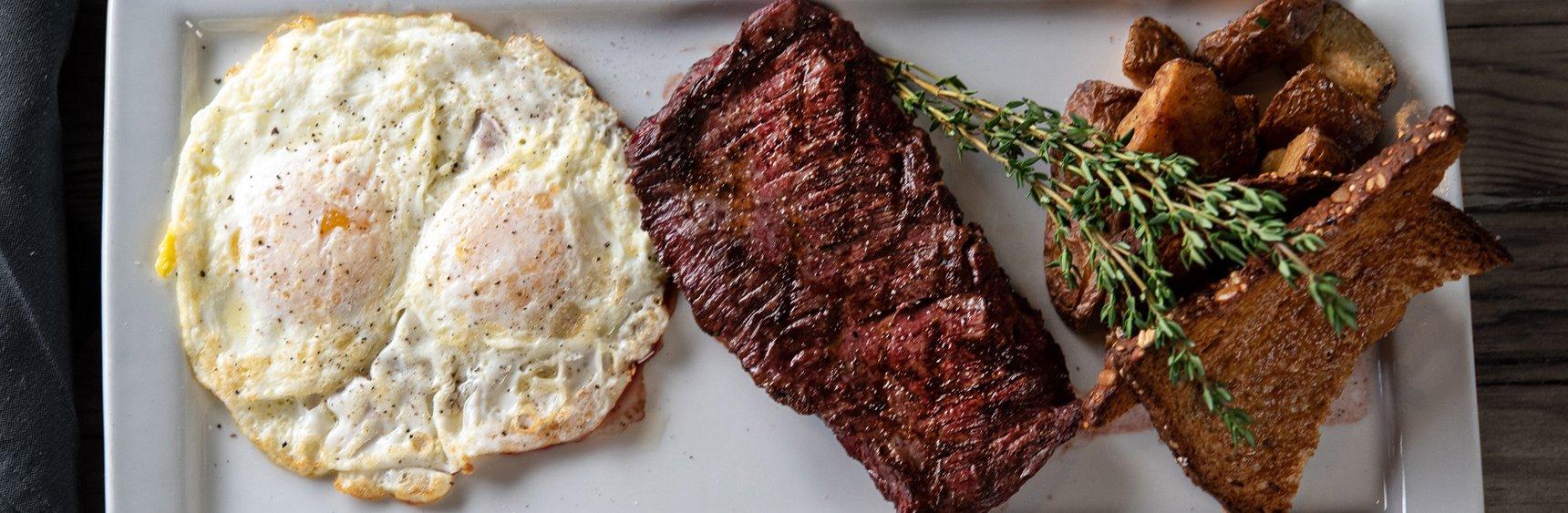 Overhead of egg and steak breakfast on plate