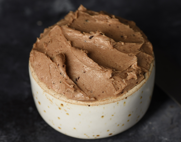 Fermented black garlic compound butter in a bowl